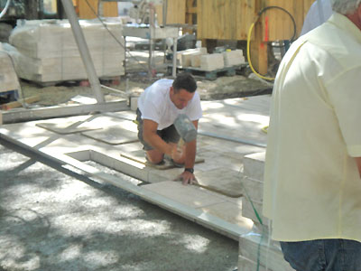 Workman setting pavers.  Copyright 2012 Marlane O'Neill.  All rights reserved.